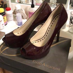Maroon leather peep toe pumps